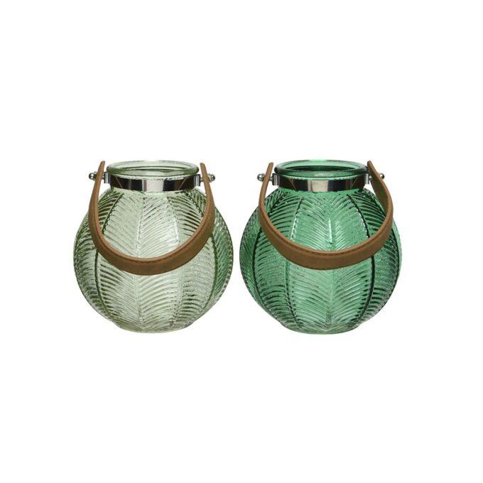 to grønne lykter i glass med skinnhåndtak