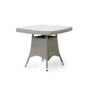 Bord med glassplater i grå kunstrotting