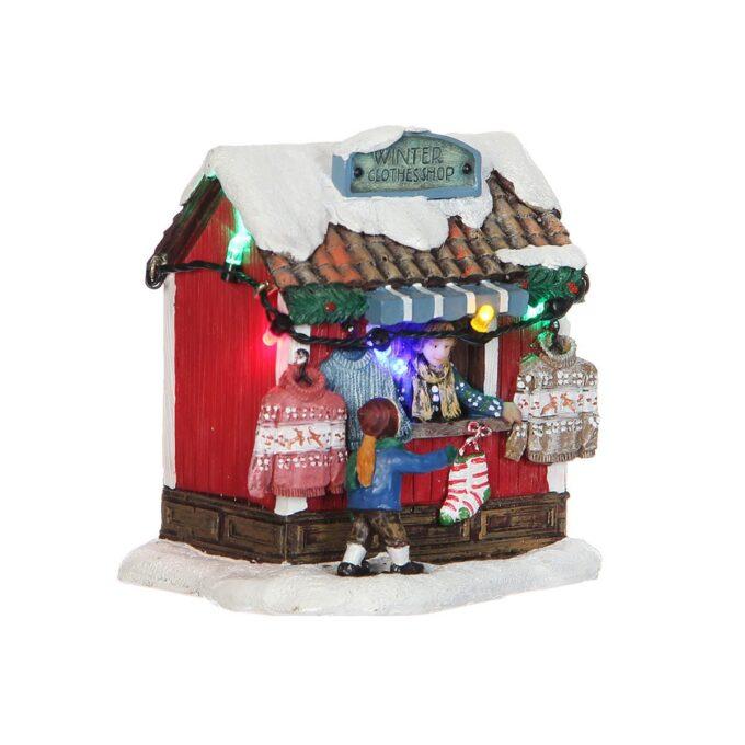 Juleby butikk med vinterklær