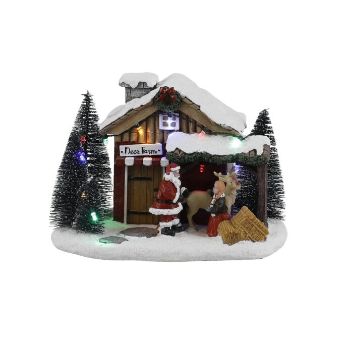 Julenissen kommer på besøk med gaver. Julehus med dyr, og bevegelse på dyrene- Denne går på batteri.