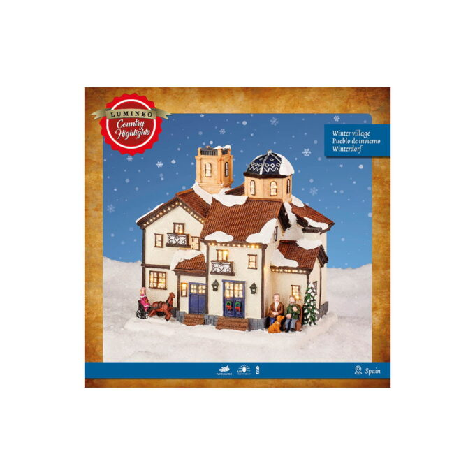 Julepyntet hus med snø på taket og lys i vinduene - julemagi. Denne går på batteri.