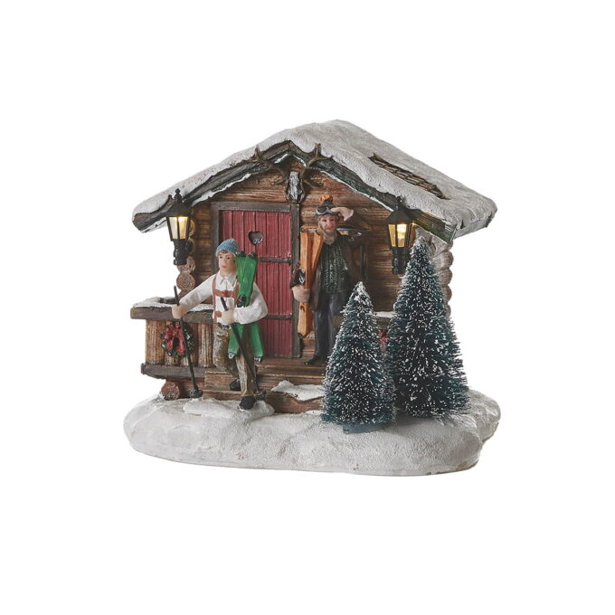 Juleby hytte Luville Nostalgisk hytte med lys og mennesker på vei ut på ski.