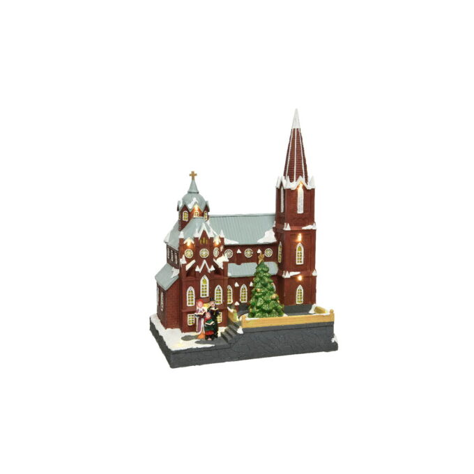 Stemningsfull katedral med et høyreist grantre og et lite kor som synger julesanger. Med musikk og bevegelse.
