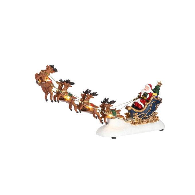 Herlig figur der nissens 8 reinsdyr flyr over nattehimmelen for å levere julegavene.