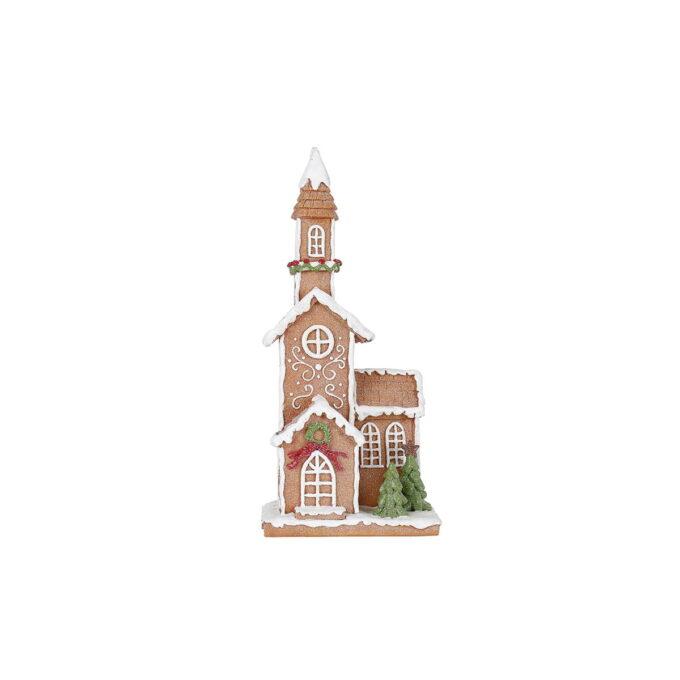 Stilren pepperkake-kirke pyntet til høytid og fest. To lubne grantrær i front setter prikken over i'en.